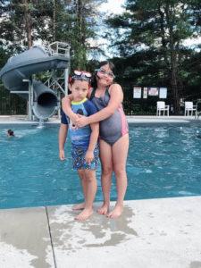 two kids at swimming pool